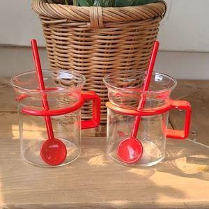 Pair of red bodum espresso mugs with stir sticks